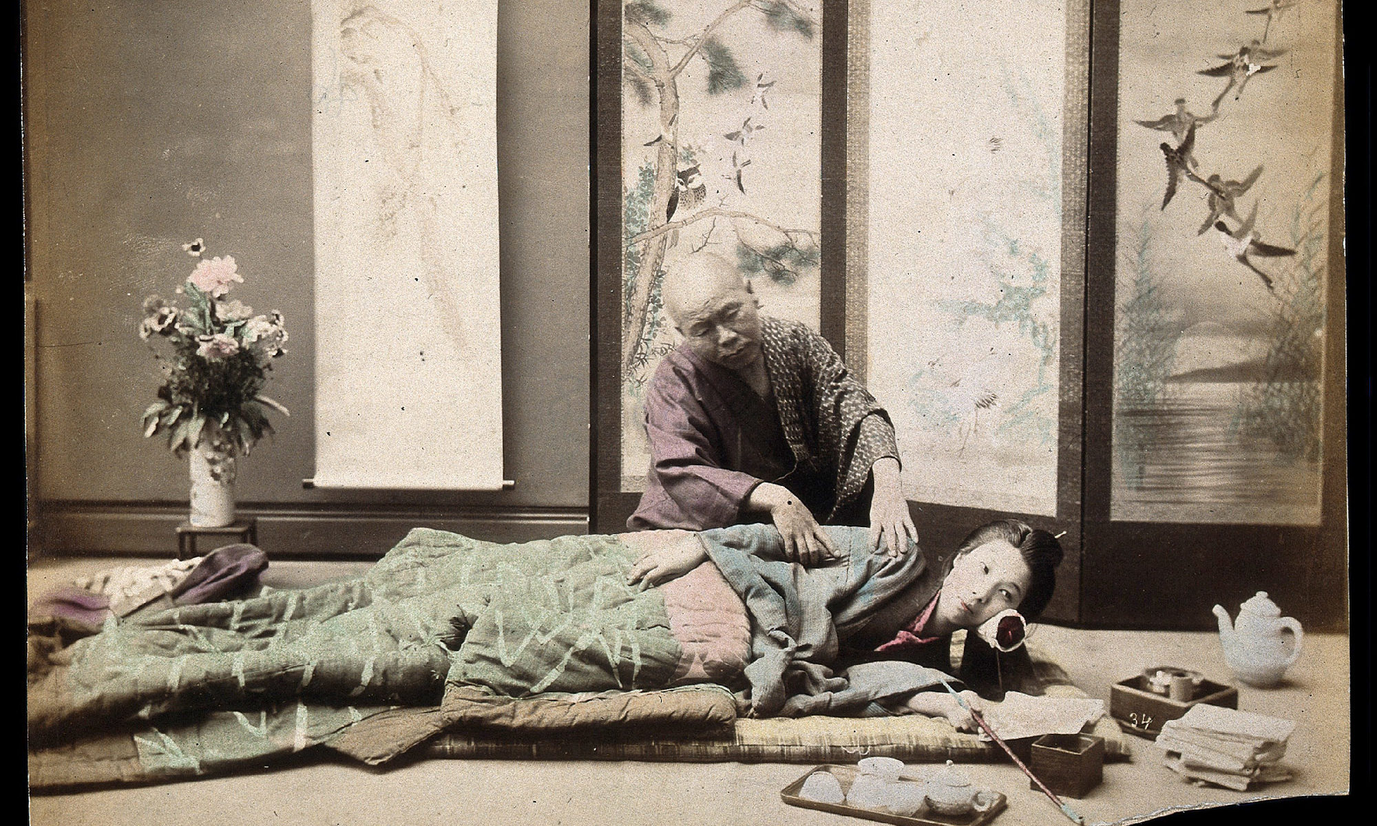 A Japanese woman being massaged by a blind Japanese